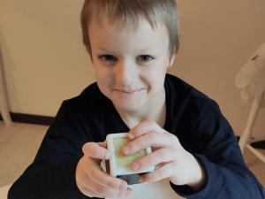Kid playing with Toucheys cube